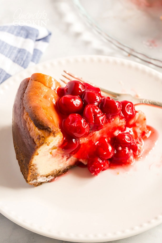 slice of cheesecake with cherry topping