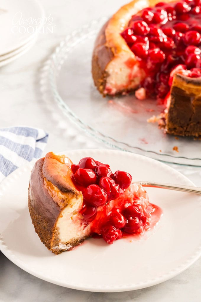 slice of cherry cheesecake on a plate
