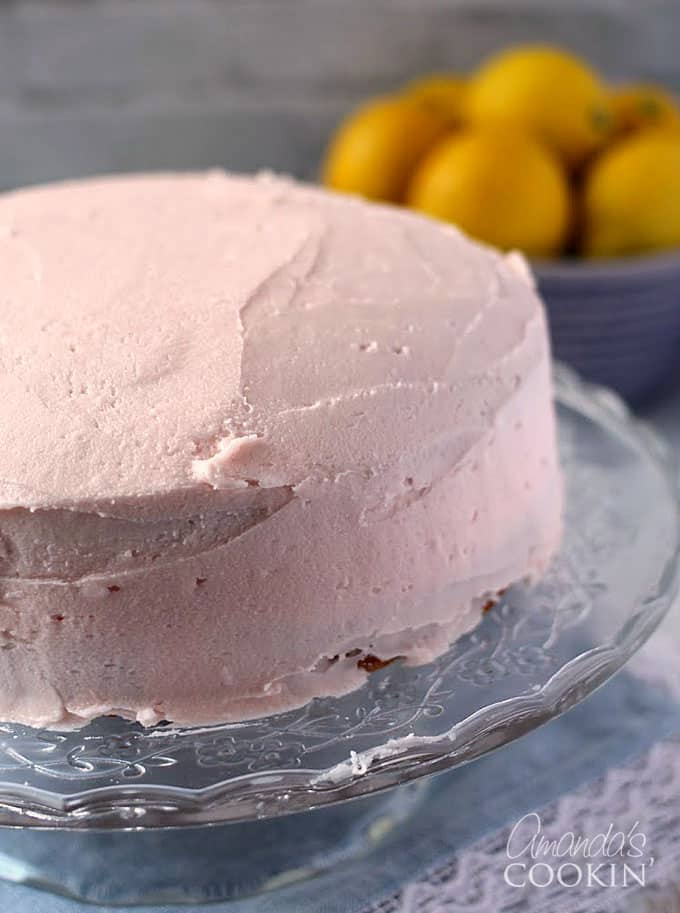 This pink lemonade cake is perfect for summer and easy to make. It starts with a cake mix and pink lemonade drink mix. Great for a summer birthday!