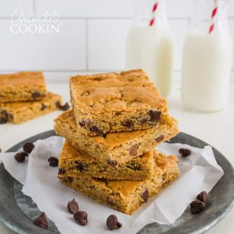 A brownie and cookie combine in sweet harmony tocreate these soft, chewy and oh so delightful peanut butter and ChocolateChip Blondies.