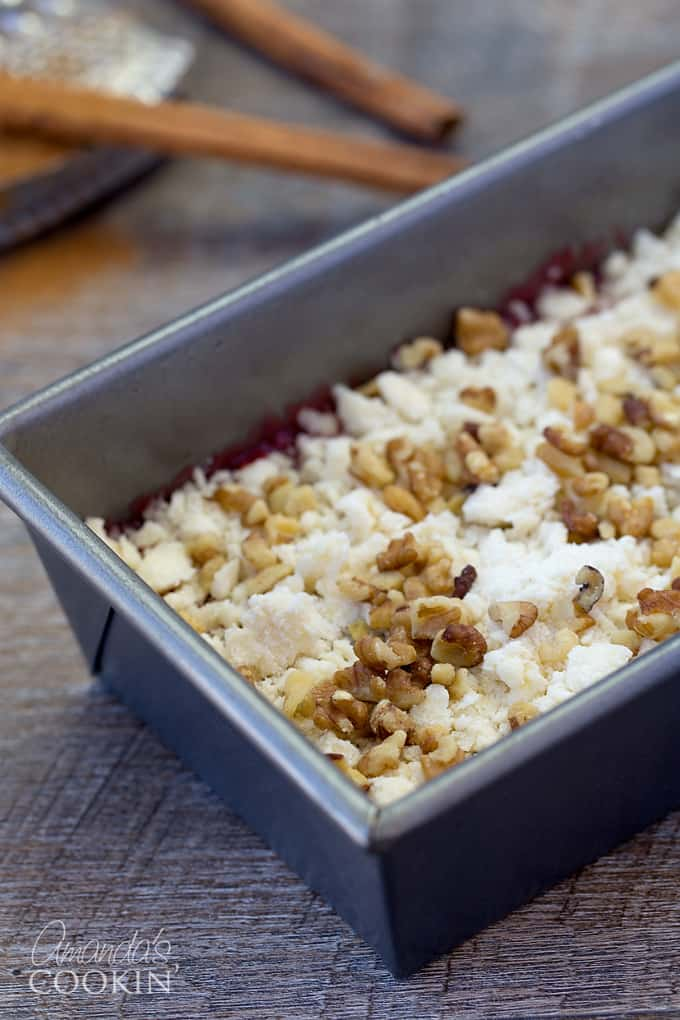 Cut in butter until crumbly. Sprinkle over batter; top with nuts. Bake at 350° for 35-40 minutes or until a toothpick inserted near the center comes out clean.