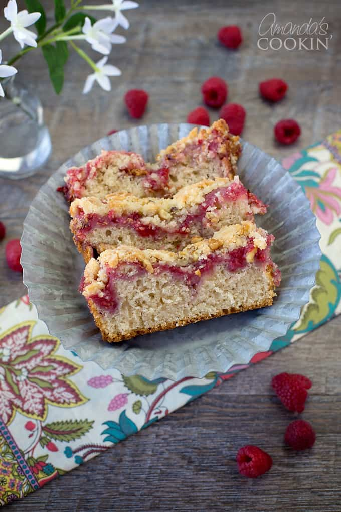 This Raspberry Coffee Cake is not an overly sweet coffee cake recipe, yet the delightfulness of the berries offsets the slightly dull cake and makes for a scrumptious morning wake-me-up!