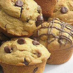 A close up photo of chocolate chip pumpkin muffins.