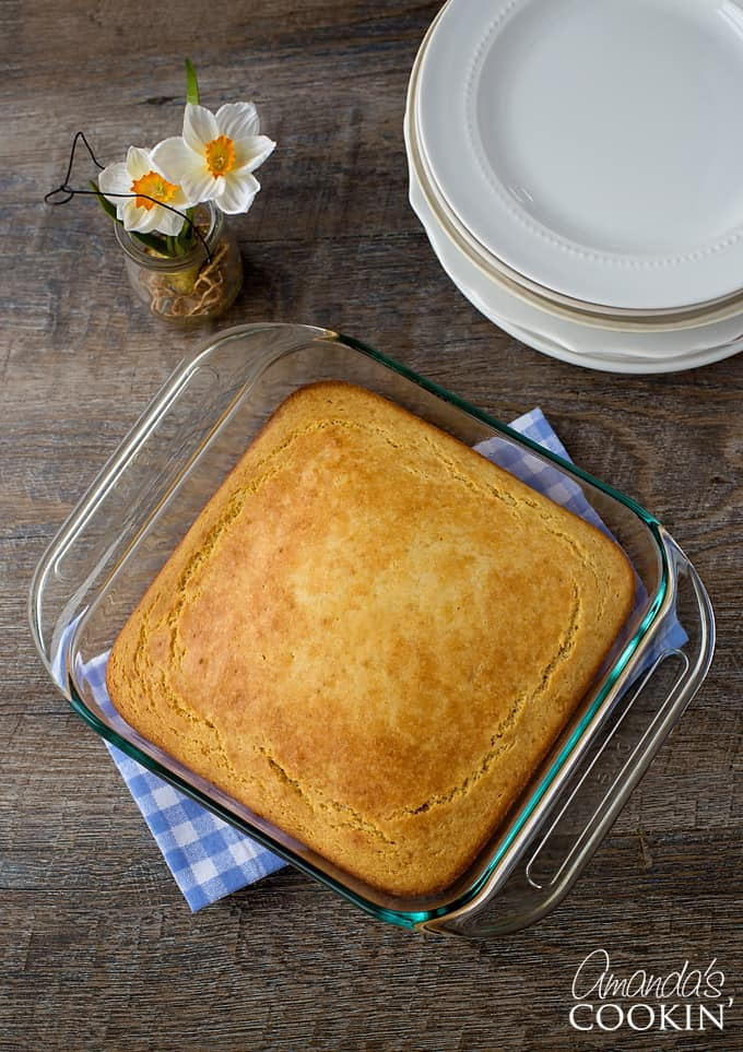 pan of cornbread on blue checkered towel