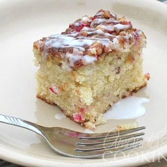 This is an ideal coffee cake for Christmas morning, full of beautiful red cranberries and drizzled with a snowy glaze. Let's be serious here. If you wanted to call this a dessert you absolutely could, but dessert for breakfast is definitely on my radar, so Cranberry Streusel Coffee Cake it is!