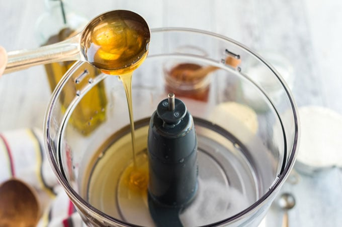 adding honey to food processor