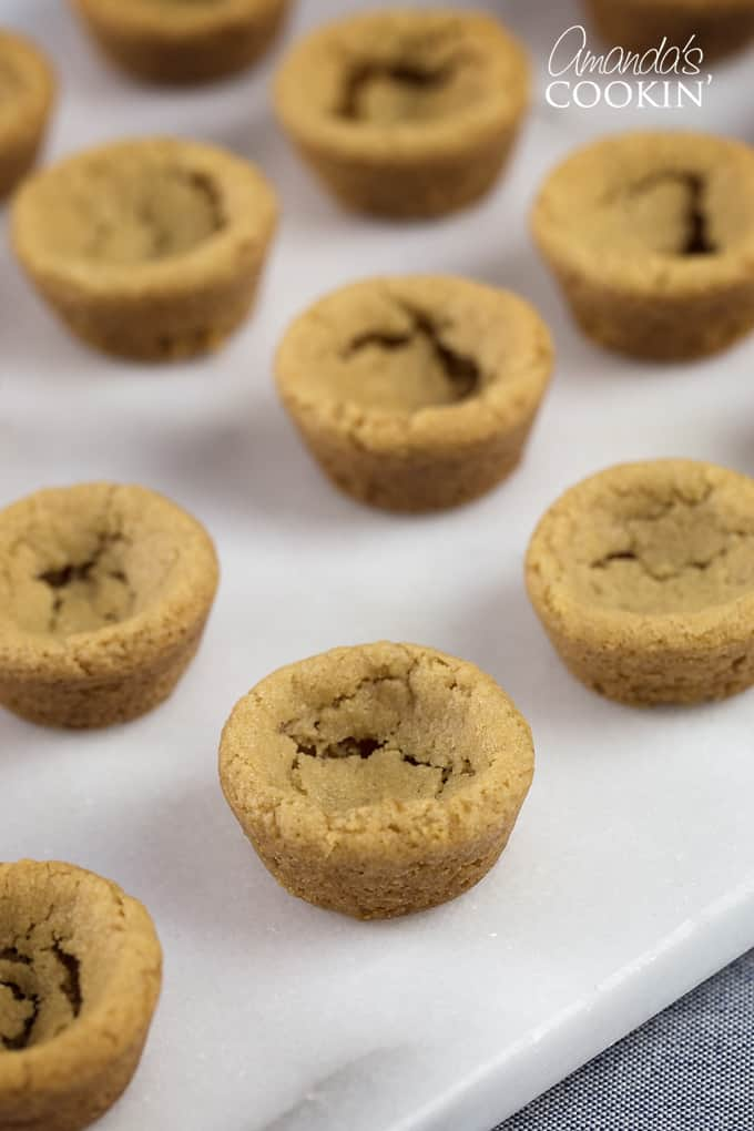 While cookie dough is still hot, push indents into the dough.