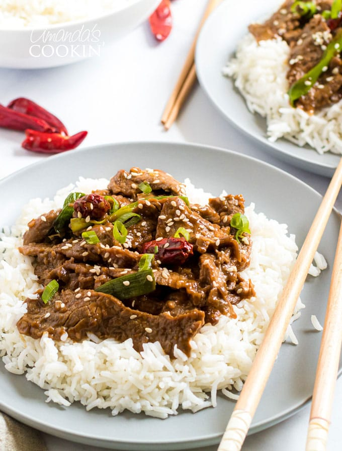 plate of Mongolian Beef with chop sticks