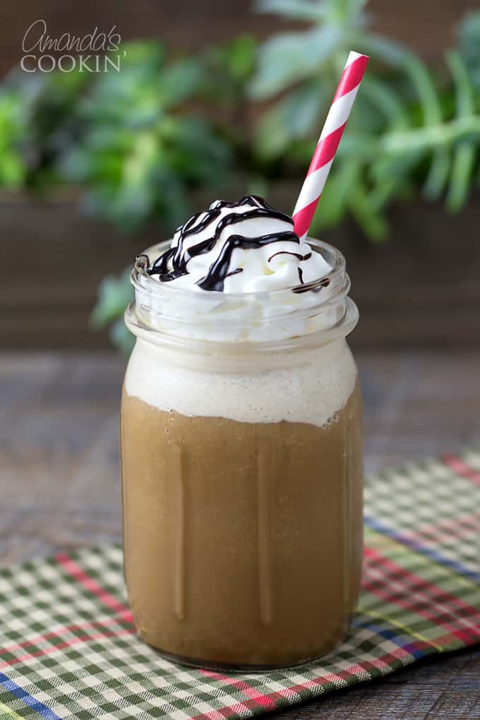 If you like Starbucks blended drinks, you will love this homemade mocha frappuccino! Full of mocha flavor and topped with fresh whipped cream, it's a less expensive alternative to coffee house drinks. So next time you crave a Mocha Frappuccino, walk over to your home blender and make one yourself.