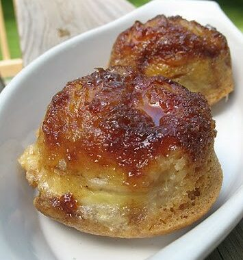 Banana upside down muffins in a white bowl.