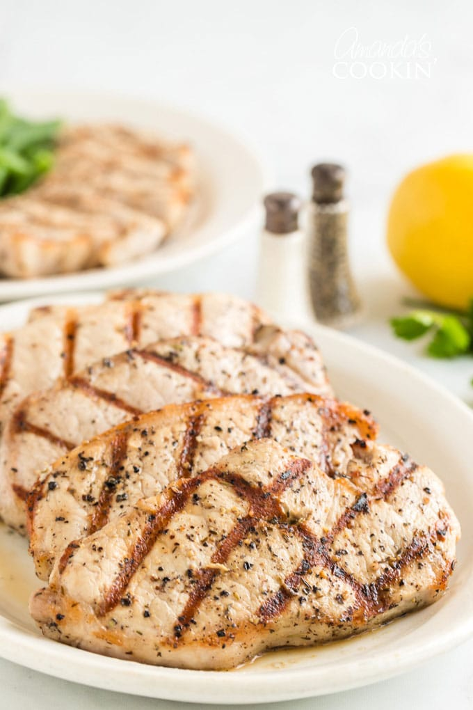 grilled pork chops on a platter