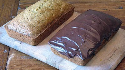 A photo of two loaves of morning glory zucchini bread.