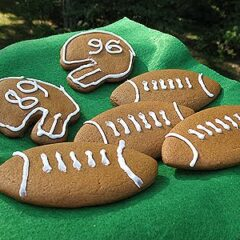 A photo of soft gingerbread football cookies resting on a napkin.