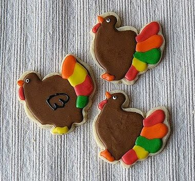 A photo of three thanksgiving turkey cookies.