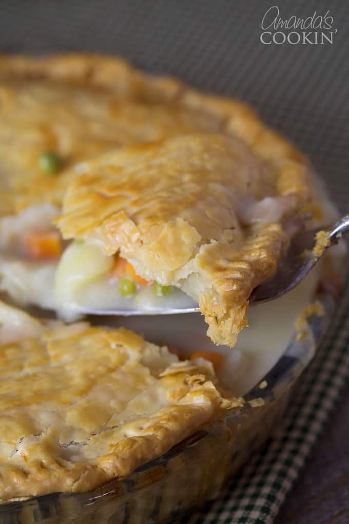 A close up of a spoonful of pot pie.