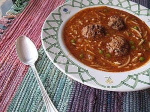A close up photo of a bowl of Amanda's meatball soup.