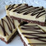 A close up photo of almond cheesecake bars.