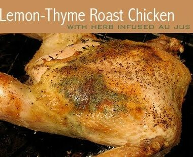 A close up photo of a lemon thyme roast chicken with jus.