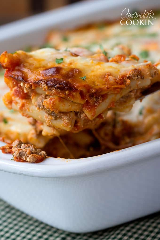 Put ziti mixture into a 13x9 baking pan and cover with the remaining 2 cups of spaghetti sauce. Sprinkle with mozzarella cheese. Bake for 30 minutes or until cheese begins to brown.