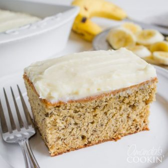 This banana cake is moist and mouth-wateringly delicious! The vanilla cream cheese frosting really kicks this beloved cake into overdrive.