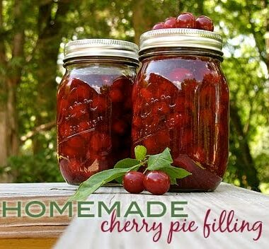 A photo of two jars of homemade cherry pie filling.