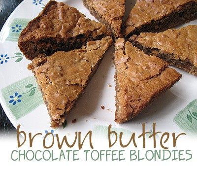 A photo of brown butter chocolate toffee blondies on a plate.