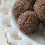 A close up photo of apple cider doughnut holes.