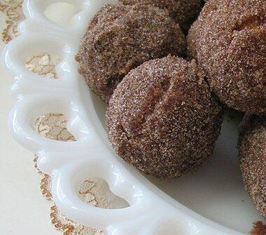 A close up photo of apple cider doughnut holes.