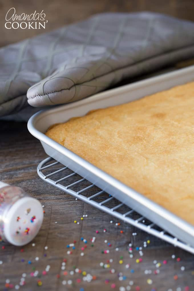 Mix together ingredients for Frosted Sugar Cookie Bars and blend until moistened. Add ingredients to a large jelly roll pan and put in over. After taking out, let them completely cool.