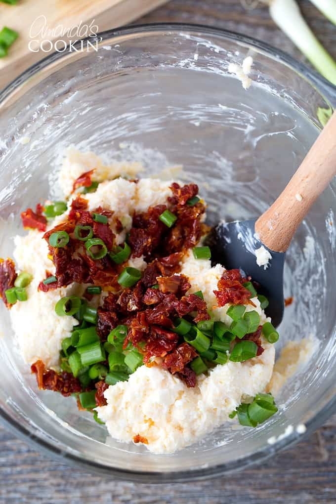 bowl of cream cheese with chives and sun dried tomatoes