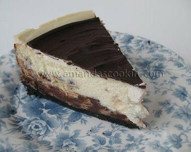 A close up photo of a slice chocolate chip ricotta cheesecake.