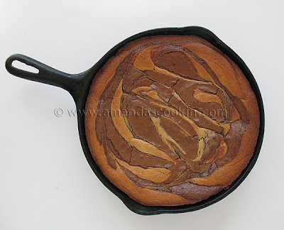 An overhead photo of a peanut butter marbled brownie skillet pie.