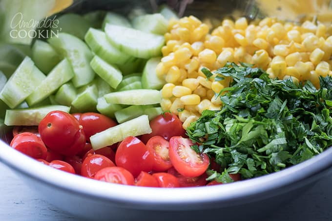 Combine ingredients in a mixing bowl for vegetable quinoa salad