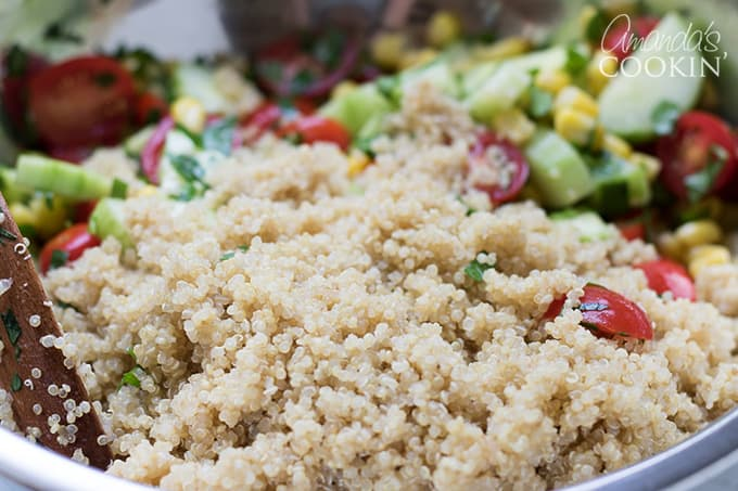 Add quinoa and toss again- summer vegetable quinoa salad.