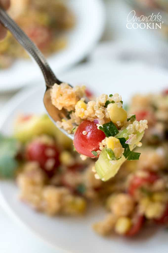 Spoonful of summer vegetable quinoa salad.
