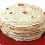 A close up photo of a stack of low fat homemade flour tortillas.