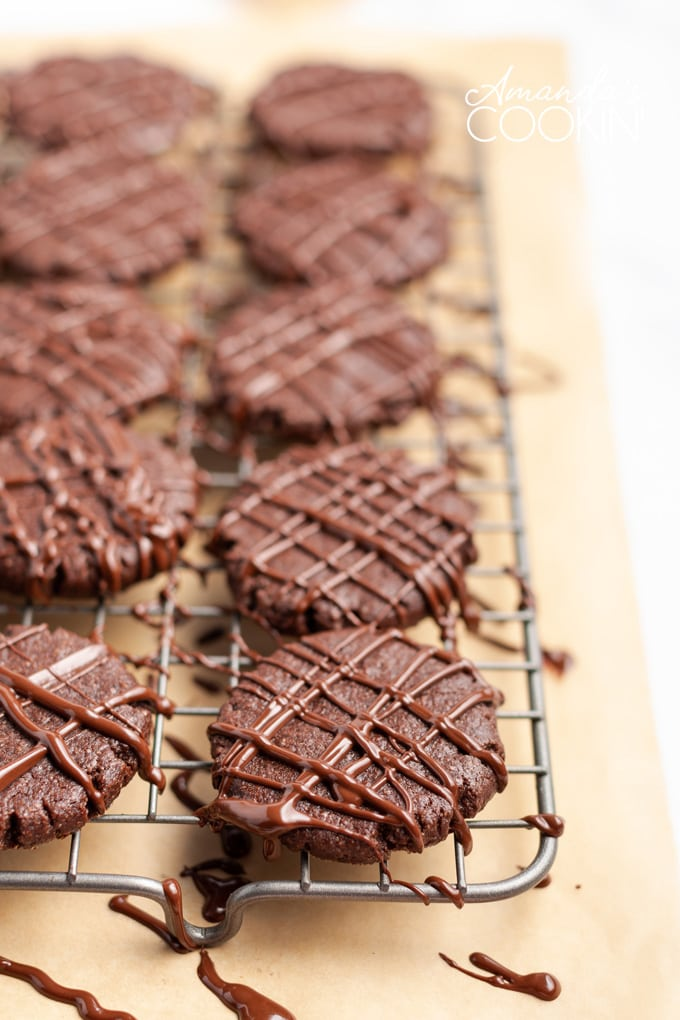 wire rack of chocolate mint cookies drizzled with melted chocolate