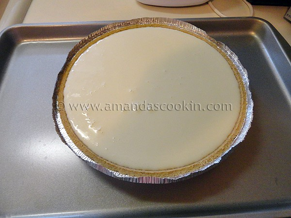 A photo of an unbaked lemonade cheesecake.
