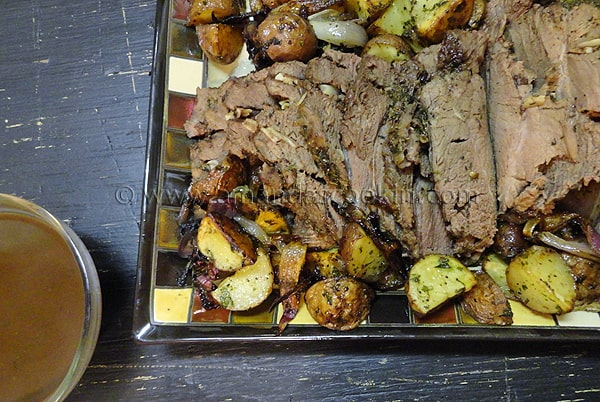 An overhead photo of a serving of perfect Sunday roast on a plate.
