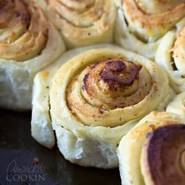 A close up of Parmesan garlic rolls.