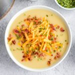 bowl of potato cheese soup garnished with bacon