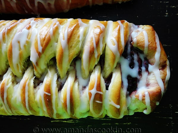 A close up overhead photo of a braided blackberry breakfast Danish.