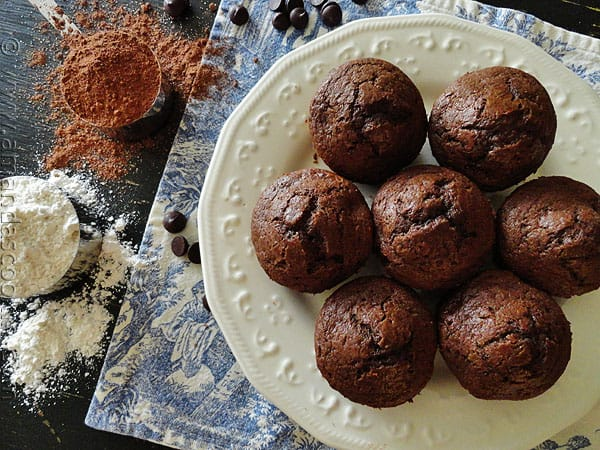 An overhead photo of copycat Starbuck\'s hot cocoa chocolate chip muffins on a white plate.