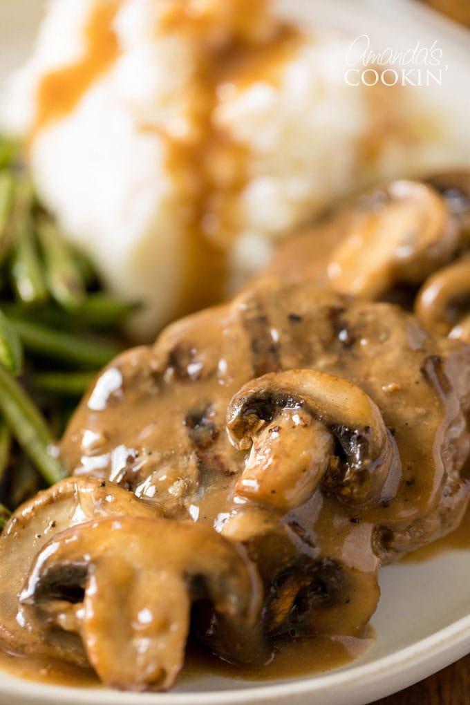 mushrooms on top of salisbury steaks with gravy
