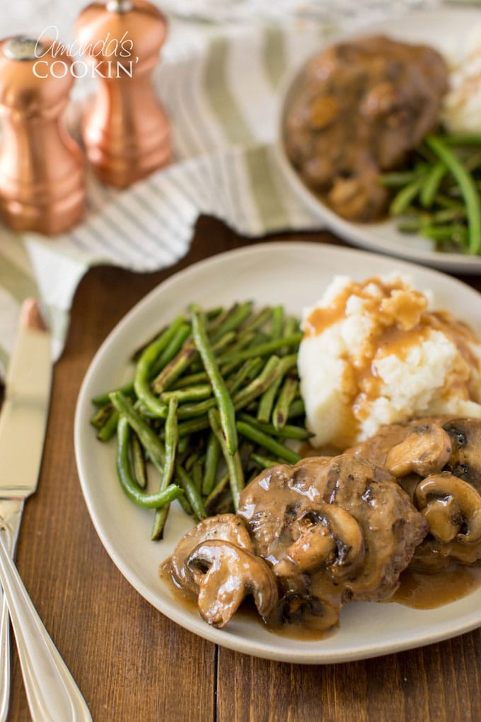 A plate of Salisbury steak on a table
