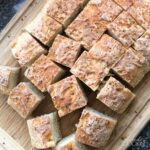 squares of peasant bread on cutting board