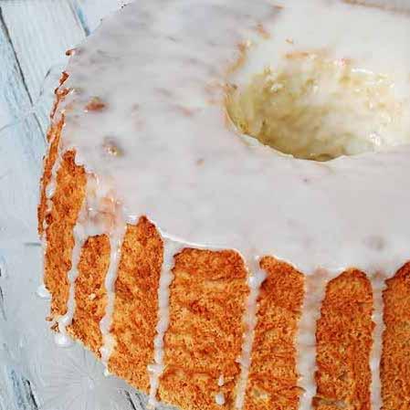 A close up photo of a homemade angel food cake.