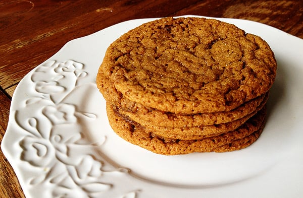 A close up photo of a stack of sugar topped molasses spice cookies