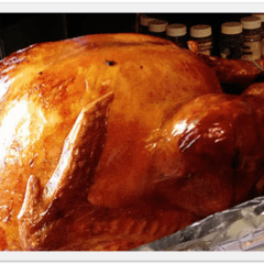 A close up photo of a cooked turkey.