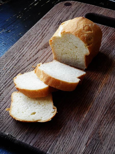 A photo of a sliced Amish white bread mini loaf.